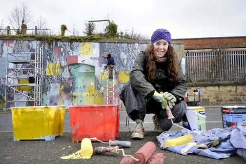 Morag Macpherson working on the mural with Tellas. Photograph by Colin Hattersley